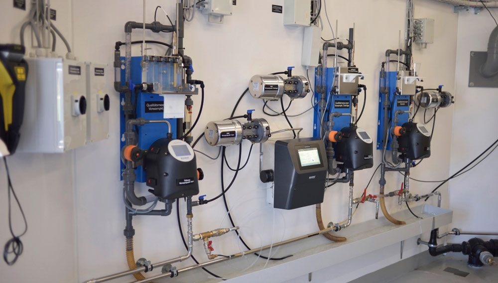 BactoSense online flow cytometer mounted on the wall along with other online analysis equipment at a Swiss water utility (Photo: Sigrist Photometer AG)