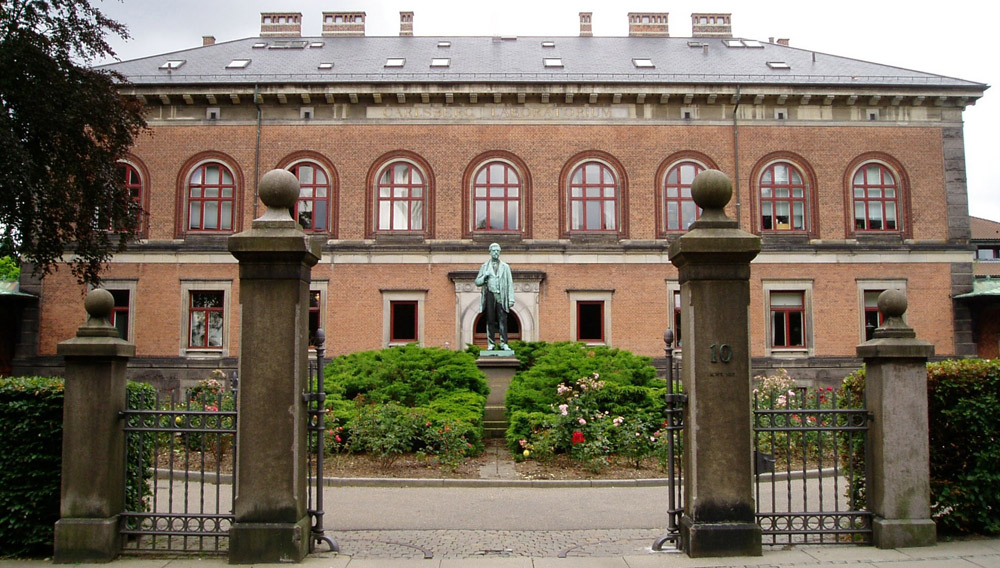 The Carlsberg laboratories with a statue of founder J. C. Jacobsen in the foreground